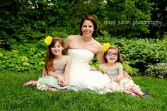 I love this idea, the mom had her portrait done in her wedding dress with her daughters for a 10 year anniversary present to her husband!