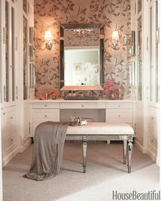 Schumacher's Whitney Floral wallpaper and a Venetian mirror give movie-star glamour to the dressing room.