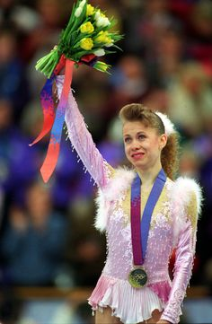 She was born in and skated for Ukraine. Russian figure skater, Oksana Baiul, was only sixteen years old when she won Olympic gold. Baiul overcame many obstacles before winning the Olympic title. Winter Olympics, Olympic Sports, Olympic Games, Olympic Ice Skating, Russian Figure Skater, Figure Skating Costumes, Olympic Gold Medals, Women Figure, Figure Skating