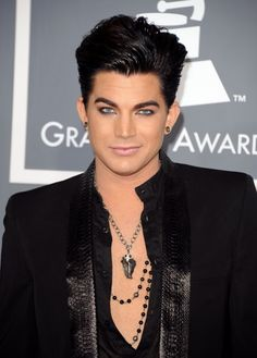 Adam Lambert is beautiful... That's bad when I find a guy that wears more make up then me attractive