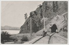 MOYIE LAKE, BC - Postcard of a man on a handcar along Moyie Lake at Jerome Tunnel circa 1900s-1910s.