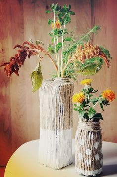 Make vases from rope, paint and old bottles or cartons. Also a fun and easy project to do with the kiddos.