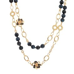 CIRO Jewelry Traviata hawk's eye gold necklace. Double strand hawk's eye beads and gold chain. White CIROLIT stones. Black enamel. 105cm long. Gold plated.