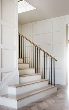 Panneled walls and a wrought iron balustrade in a Texas home by Coats Homes and Turney and Associates Architects Photo by Costa Christ Stair Handrail, Staircase Railings, Staircase Design, Stairways, Banisters, Handrail Ideas, Spiral Staircases, Stairway Railing Ideas, Modern Stair Railing