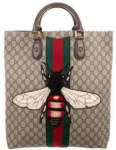 2d6502e7427b Gucci Web Animalier GG Supreme Tote