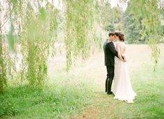 intimate photo under weeping willow tree