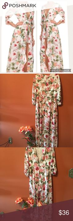 Floral Printed Romper Maxi Dress Brand New, Size Large,  Floral Printed Romper features lined shorts a deep vneck button tab sleeves and a back zip closure and attached Maxi skirt overlay Xtaren Dresses Maxi