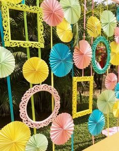Found this fun Mehendi decor with photo frames and paper fans. Were tempted to…