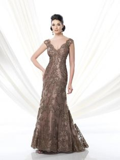 Ivonne D 214D56 Mother of the Bride Dress- Lace over taffeta fit and flare slim A-line floor length evening dress with cap sleeves, scalloped front and back V-necklines. Suitable for the mother of the bride or the mother of the groom. Matching shawl included. Colors: Bronze, Wedgwood, Wine