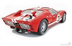1966 FORD GT 40 MKII #3 1:18 Scale - Opening doors, hood and engine compartment. - Rolling wheels w/ working steering w/ deailed undercarriage and chassis detail. - Gloss red paint finish w/ authentic