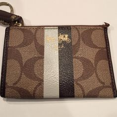 """Keychain wallet Looks brand new except leather by end of zipper is sticking up. Authentic . 4 1/2"""" x 3""""  side pocket, zip closure Coach Bags Wallets"""