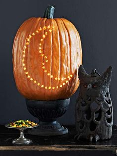 Sure, that toothy grin is fun, but let's mix it up this year with these stylishly fun carving ideas for your Halloween jack-o'-lantern. Pumpkin Moon, Spooky Pumpkin, A Pumpkin, Pumpkin Ideas, Halloween Activities, Halloween Crafts, Halloween Decorations, Halloween Ideas, Halloween Quotes
