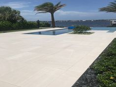 This modern pool has a light colored stone look porcelain tile called Sands White. Great for indoor and outdoor use. There are different colors, styles and sizes available. Modern Pools, Porcelain Tiles, White Tiles, Sands, Different Colors, Indoor, Exterior, Dreams, Stone