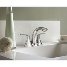 We love the petal–like handles and swan neck spout of this lovely bathroom faucet.