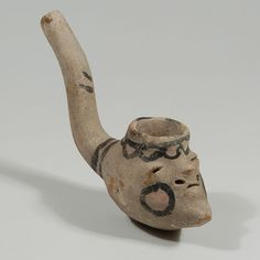 "#adobegallery - Tesuque Pueblo Pottery Figural Smoking Pipe. Potter Unknown      Category: Historic     Origin: Tesuque Pueblo - Te Tsu Geh Oweenge     Medium: clay, pigment     Size: 5-1/2"" long x 1-5/8"" width     Item # C3687A"