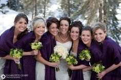 Bridesmaids in purple and green.  Love the scarfs for a chilly day!