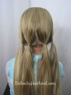 Easy Vintage Updo from BabesInHairland.com. Lots of other styles for little girls or me also