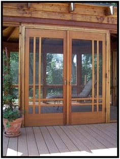 We found some double screen doors for the back porch at a salvage yard...may make it work with new doors though