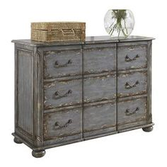 "Distressed wood chest with three drawers and antiqued pewter hardware. Top drawer is felt lined.     Product: Chest  Construction Material: Wood  Color: Weathered blue    Features:   Three drawers   Top drawer is felt lined    Carved corner accentsHeavily distressed finishAntiqued pewter hardware            Dimensions: 32"" H x 44"" W x 18"" D"