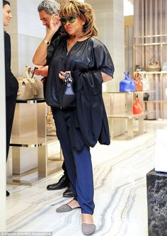 Shady lady: Tina Turner enjoyed a shopping spree in Milan, Italy on Monday while at the Giorgio Armani boutique
