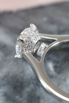 This gorgeous engagement ring features a unique peekaboo diamond pattern under the center diamond, otherwise making it look like a solitaire from the top view. Designed and created by Joseph Jewelry   Seattle, WA   Bellevue, WA   Online   Design Your Own Engagement Ring   #engagementring