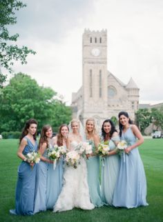 Mismatched long dresses in varying shades of blue..  Read more - http://www.stylemepretty.com/2013/11/13/minnesota-wedding-from-emily-steffen-photography/