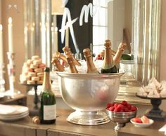 Set up a simple elegant champagne bar with raspberries, strawberries, chambord, and some chocolates
