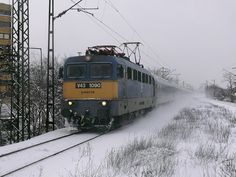 Through the snow, hungarian train is arriving to Budapest station Commercial Vehicle, Train Station, Locomotive, Bridges, Budapest, Traveling, Action, Change, Landscape