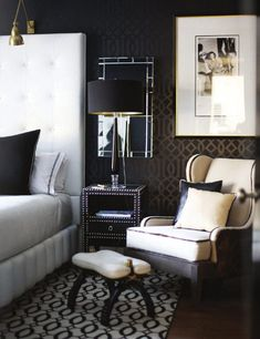 master bedroom - dark wallpaper, tall white headboard, black accents