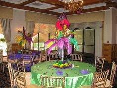 Elegant Mardi Gras themed centerpieces for a sweet 16 at Andover Country Club in Andover MA Mardi Gras Centerpieces, Masquerade Centerpieces, Mardi Gras Decorations, Table Centerpieces, Casino Theme Parties, Party Themes, Party Ideas, Sweet Sixteen Parties, Casino Cakes