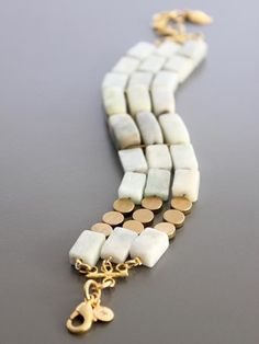 3 strand bracelet with amazonite, new jade, and brass beads.