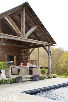 A rustic post and beam pool house.  Architectural and interior design: Marisa Bistany Perkins, M West Designs, Photography by Laura Moss