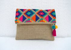 Bohemian linen colour foldover clutch with vibrant multicolour embroidery of classic Kilim pattern.  It is made of natural colour burlap like pure linen fabric. The inside is lined with matching linen colour cotton fabric The bag has matching zip closure with brass puller which is decorated with funky, bohemian hand made tassel  Size : height - 8 inches ( folded ) , 12 inches ( unfolded)  width - 10 inches  * In stock, ready to ship * For regular updates, visit our facebook page https:/&...