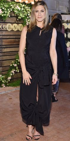Jennifer Aniston in a playful black dress that featured cool twisted knots at the neckline, waist and hemline.