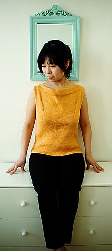 Free knit pattern, With a little feel of the early 1960s, this draped boatneck tank is simple yet striking. It can easily be dressed up or down. Wear it with skinny jeans and ballet flats, and you're ready to dance in your living room for a room full of dinner guests.