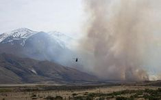 A Lake Ohau Village resident says the village now resembles a war zone, with about 30 houses and many cars destroyed by a wildfire that has blitzed the Mackenzie Country area.