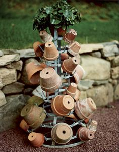 Inverted flowerpots ornament a French plant stand. So how do I get one home from France? Albert Hadley, Pot Storage, Garden Structures, Garden Buildings, Diy Greenhouse, Garden Pots, Garden Sheds, Garden Deco, Clay Pots