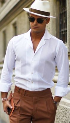 I really like this modern take, (read: slimmer fit), on an older look. This man has a great sense of fashion.