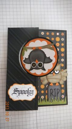 Halloween punch-art bat and mummy owls (closed) ~ C/S - black, pumpkin, gray, crumb cake, whisper white Ink: black, crumb cake Accessories: Thin-lit circle die, owl punch, scallop punch, Lg. oval punch (branch), bird builder punch (leaves), thin-lit label die (spooky label)