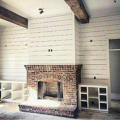 I like the fireplace with short bookshelves.