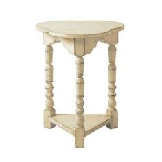Display your favorite object d'art or a vase of fresh wildflowers on this eye-catching design, offering style and flair for your well-appointed home.    Product: Side table   Construction Material: Solid hardwood Color: Distressed white    Features: Classic French laundry style    Dimensions: 26 H x 21.25 W x 20 D        Note: Assembly required