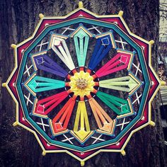 Mandala Wishes for 12 months. 40cm This mandala is made for upcoming year for making a certain wish for every of 12 months. Once you set your order, please be prepared to have 12 wishes ready :) The brooche with sun is attached as example that you can attach something into center