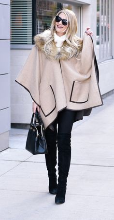 How beautiful is this beige cape! Love the black over the knee boots with it!