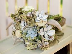Bouquet of ranunculus, wax flower, Queen Anne's lace, scabiosa pods, succulents and deer antlers // Arizona Bride