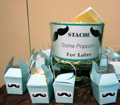 I had fun planning and setting up this shower! First the simple homemade Chocolate Mustache Pops Centerpiece. I wrapped tin cans with must...
