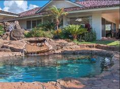 This island-like backyard swimming pool is the perfect escape for homeowners who can't get away!