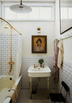 Every home should have: White marble bathrooms with brass fixture