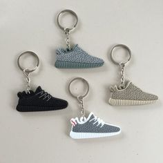 Yeezy Keychain set bundle of 4 Awesome keychain bundle! Perfect for giving out as gifts! Comes with turtle dove keychain, pirate black, moonrock and Oxford tan! Please let me know if you would like to purchase just one or two and I can create a seperate listing Accessories Key & Card Holders