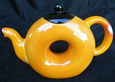 Ceramic Teapot and matching Cup with hand painted original orange and black design. Unique tea set for one.. $99.00, via Etsy.