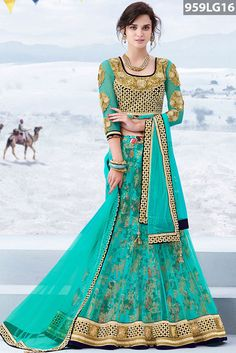 Turquoise net lehenga designed with zari embroidery, stone, beads, applique, cutwork and patch border work highlighted with floral printed linling. Black velvet embroidered choli with turquoise net sleeves and turquoise net dupatta are available with this.Price US$ 186